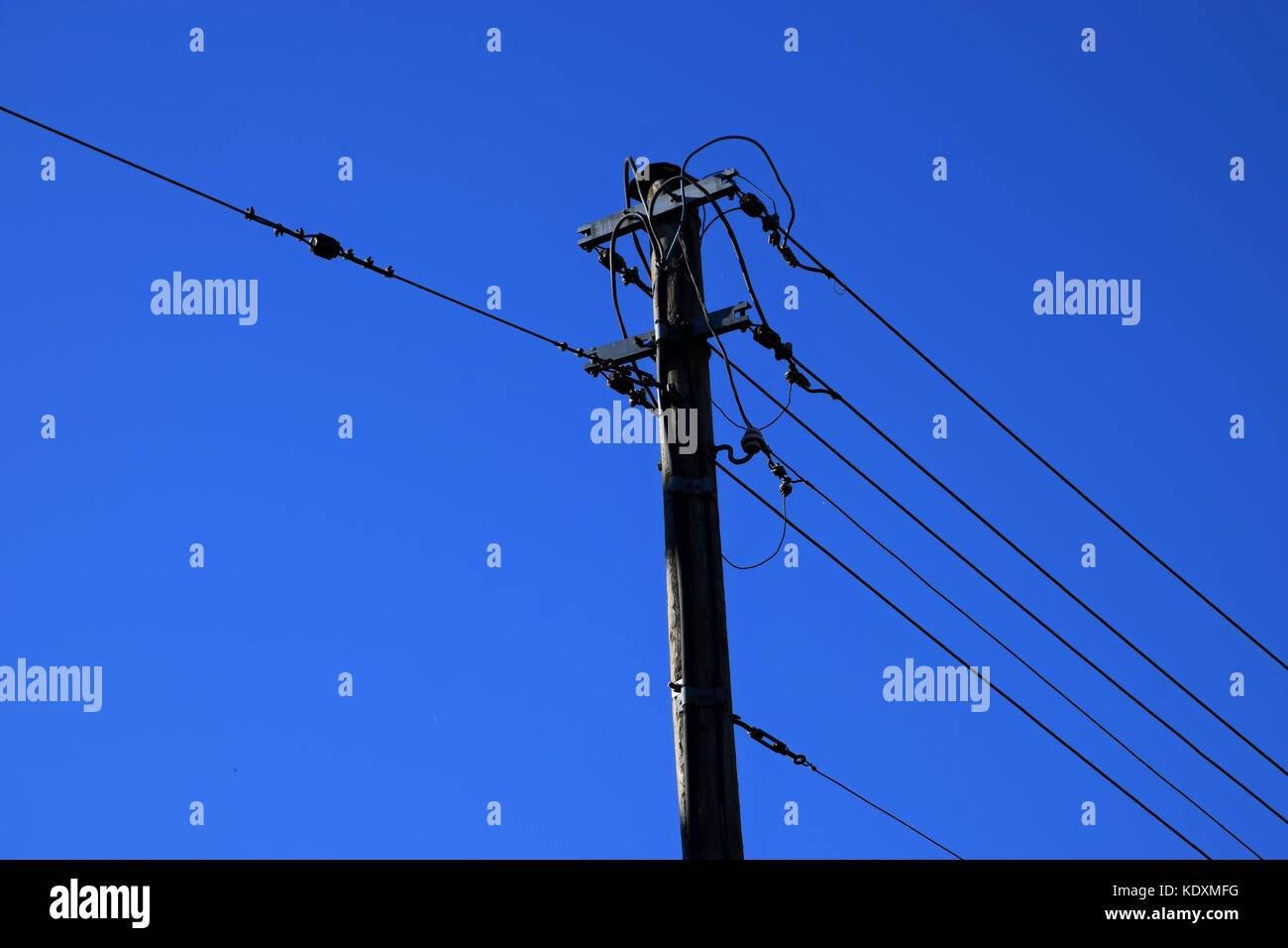 high power pole in the Country, power cable in autumn with colorful blue sky Stock Photo