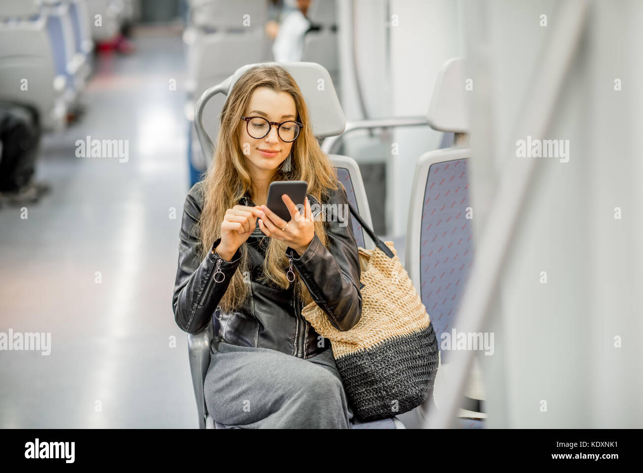 Woman riding at the modern train - Stock Image