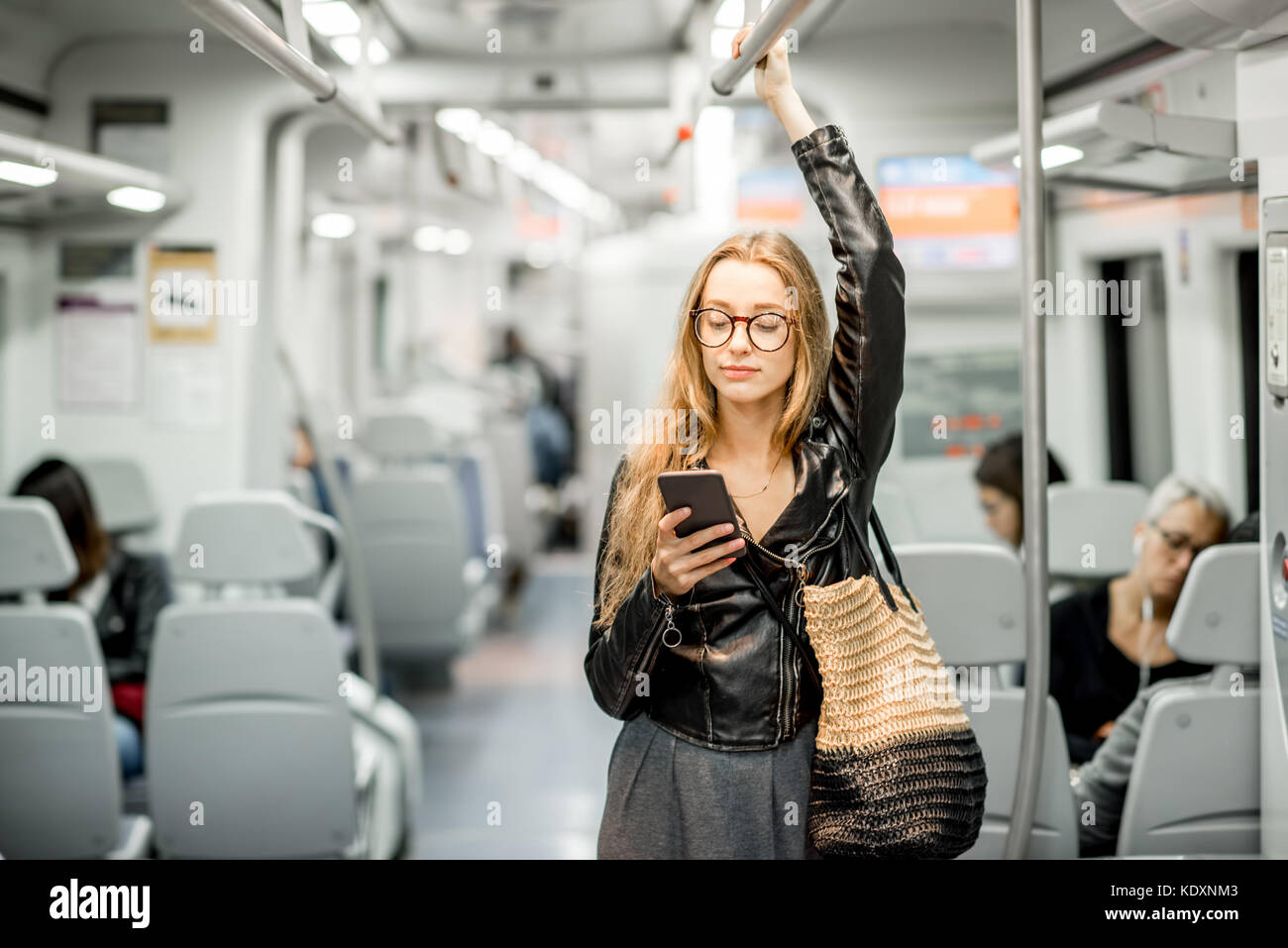 Woman riding at the modern train Stock Photo