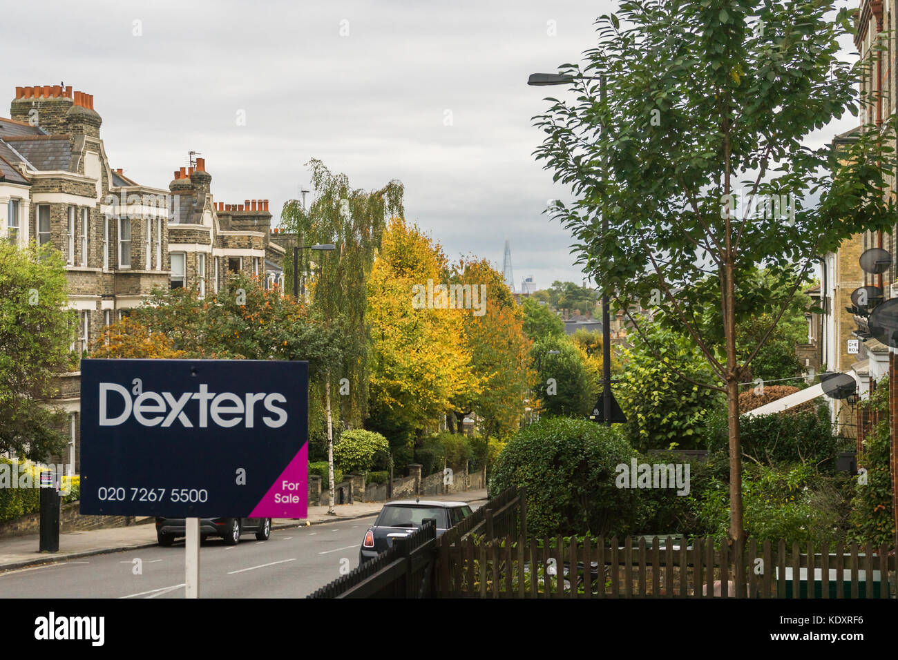 Dexters Estate Agent 'For Sale' sign in Dartmouth Park Hill during autumn in North London, England, UK - Stock Image