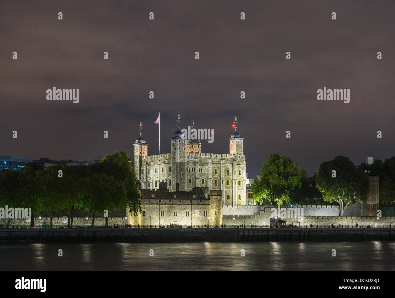 The illuminated Tower of London - a historic landmark building at night, City of London, England, UK - Stock Image
