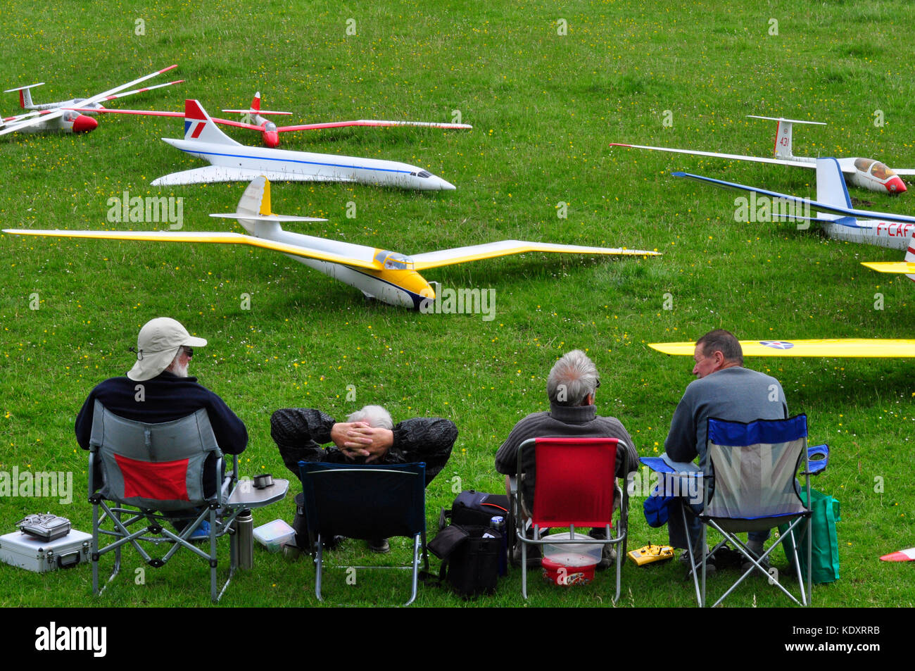 Radio controlled model gliders with their owners awaiting the right conditions for launching from White Sheet hill - Stock Image