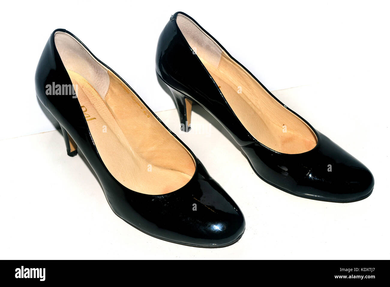 d17605435642 Ladies patent leather black shoes photographed against a white background -  Stock Image