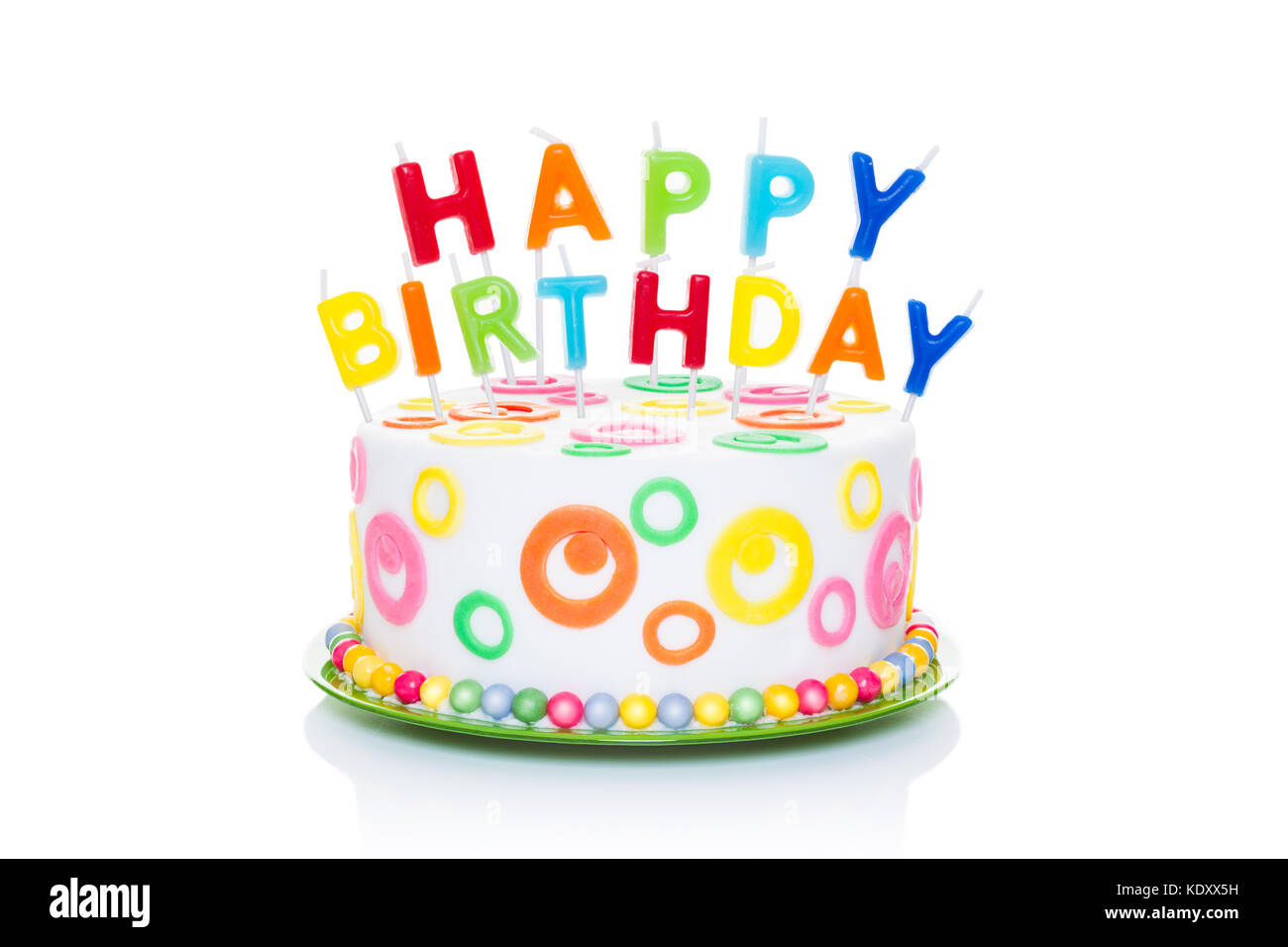 happy birthday cake or tart with happy birthday letters as candles very colorful and looking very tasty isolated on white background