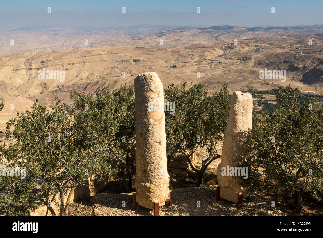 Roman milestone pillars in foreground, which lined the ancient pilgrimage route between Jerusalem and Mount Nebo, - Stock Image