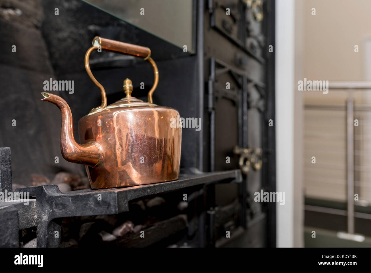 Vintage And Antique Copper Kettle On A Victorian Stove In A