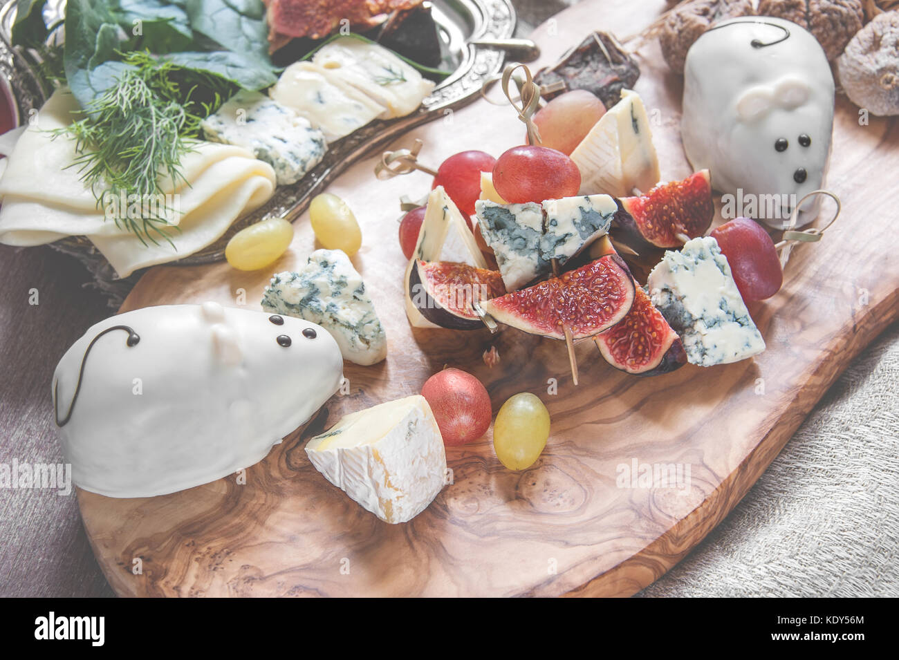 Italian Focaccia bread with cheese and a cheese plate with figs and Gorgonzola brie DorBlu and grapes. The horizontal frame. & Italian Focaccia bread with cheese and a cheese plate with figs and ...
