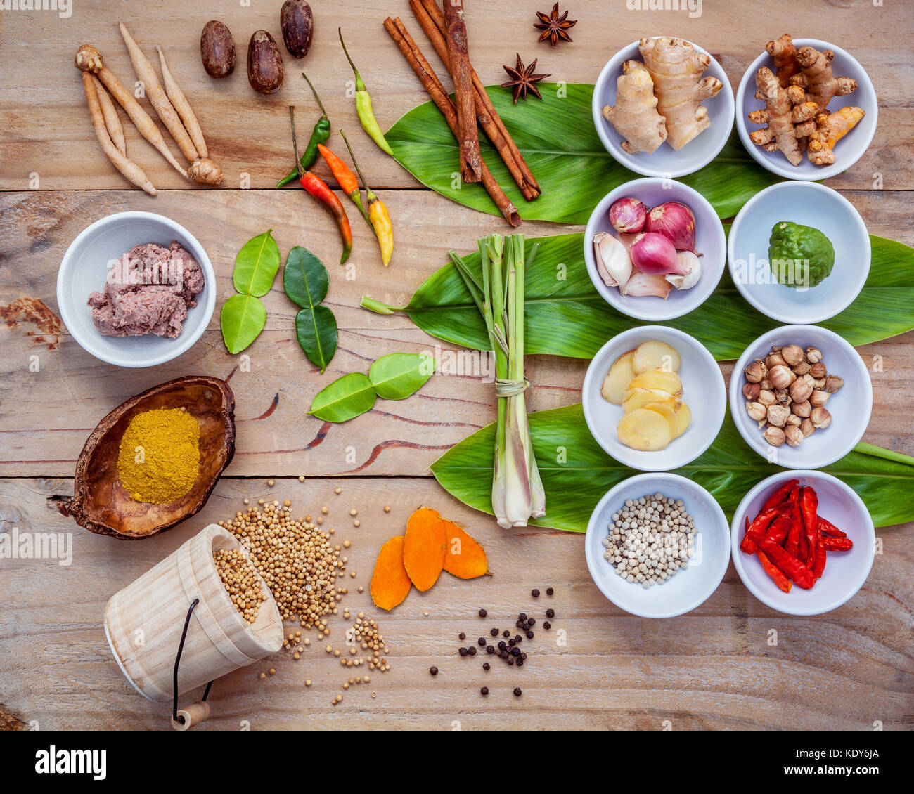 Various of thai food cooking ingredients for spice red curry paste ingredient of thai popular food on galanga leaf - Stock Image