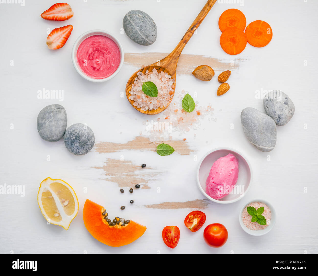 Homemade skin care and body scrubs with red natural ingredients strawberry , tomato ,himalayan salt,papaya, carrot - Stock Image