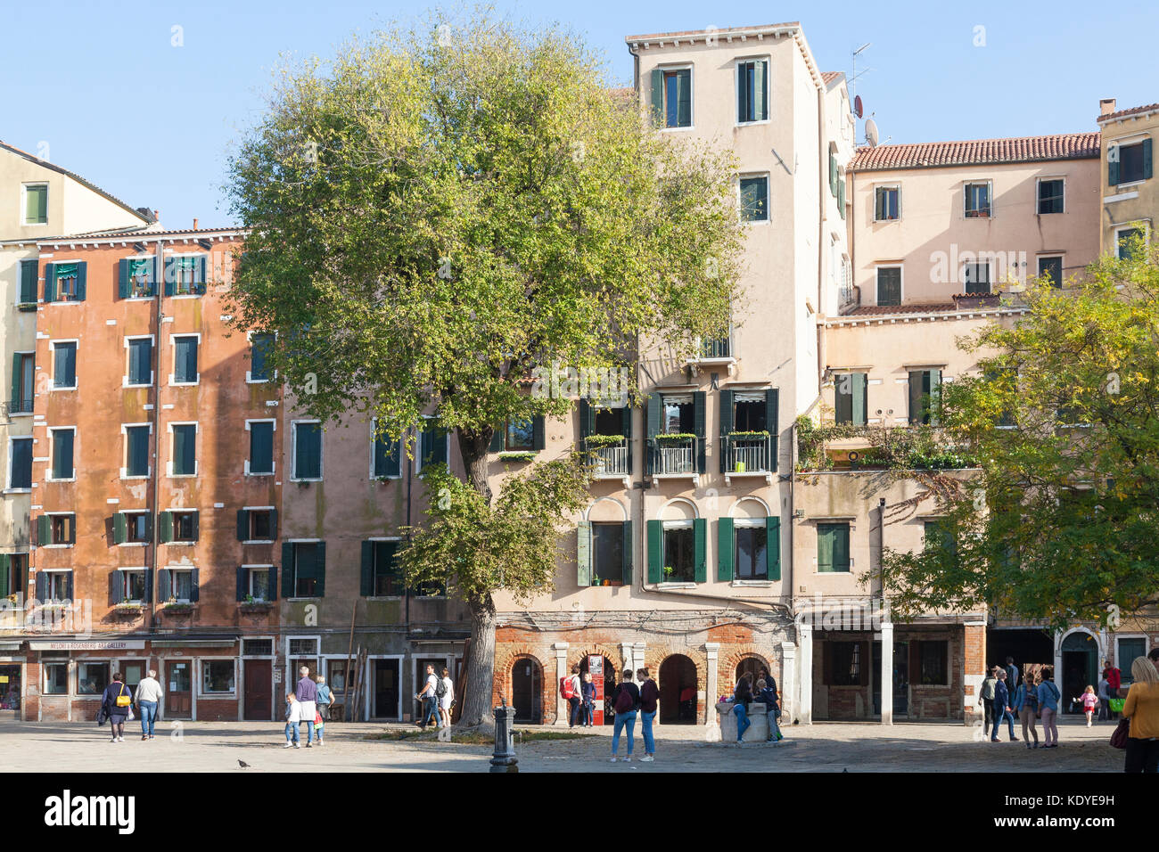 Tall colorful buildings in Campo Gheto Novo, Cannaregio, Venice, Italy built many stories high as the Jews were - Stock Image