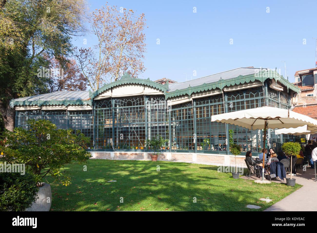 Serra dei Giardini restaurant in the historic old greenhouse in the Public Gardens, Castello, Venice, Veneto, Italy - Stock Image