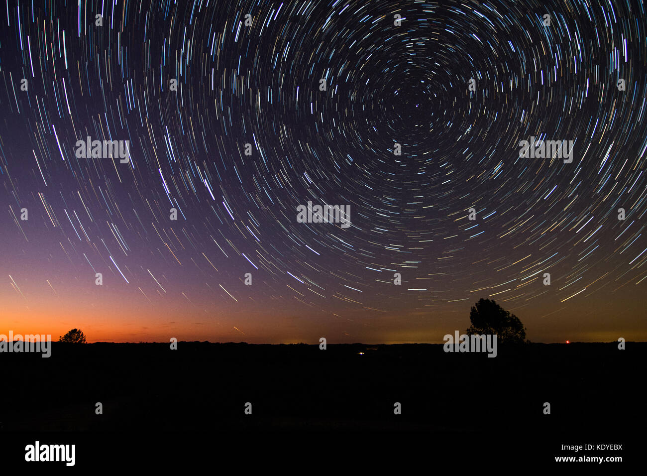 Star trails illustrate the rotation of the Earth. - Stock Image