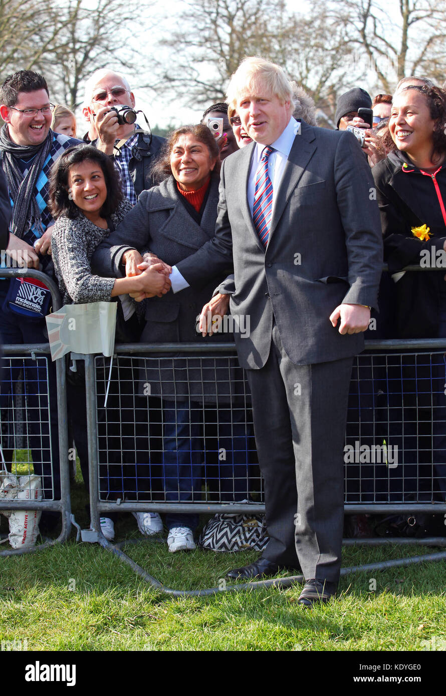 LONDON, ENGLAND - MARCH 29: Crowds cheer as Queen Elizabeth II arrives in Valentine's Park Redbridge as part of Stock Photo