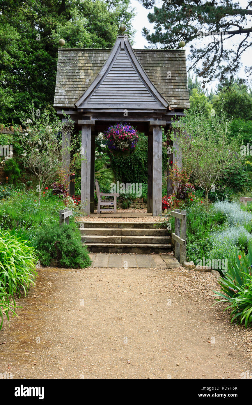 Wood and tile gazebo allows visitors to sit and contemplate in Abbotsbury Subtropical Gardens, Dorset,UK - Stock Image