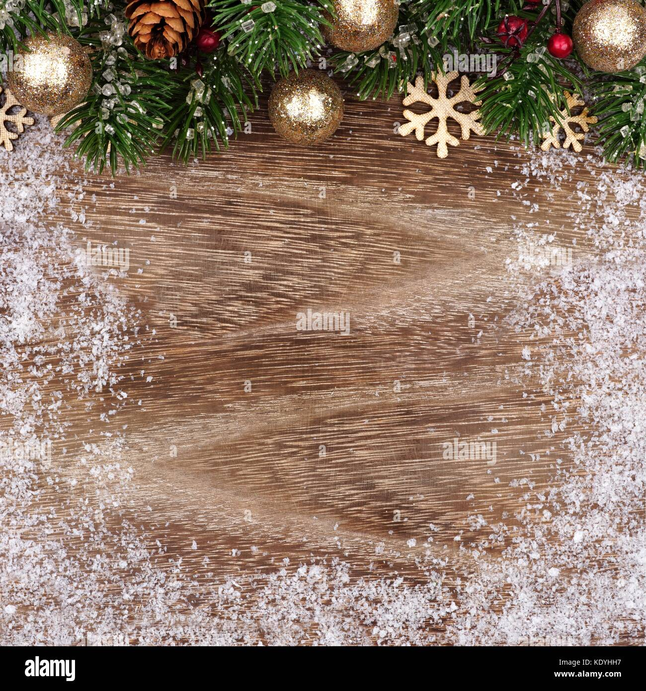 Christmas Top Border With Gold Ornaments Branches And Snow Frame On A Rustic Wood Background