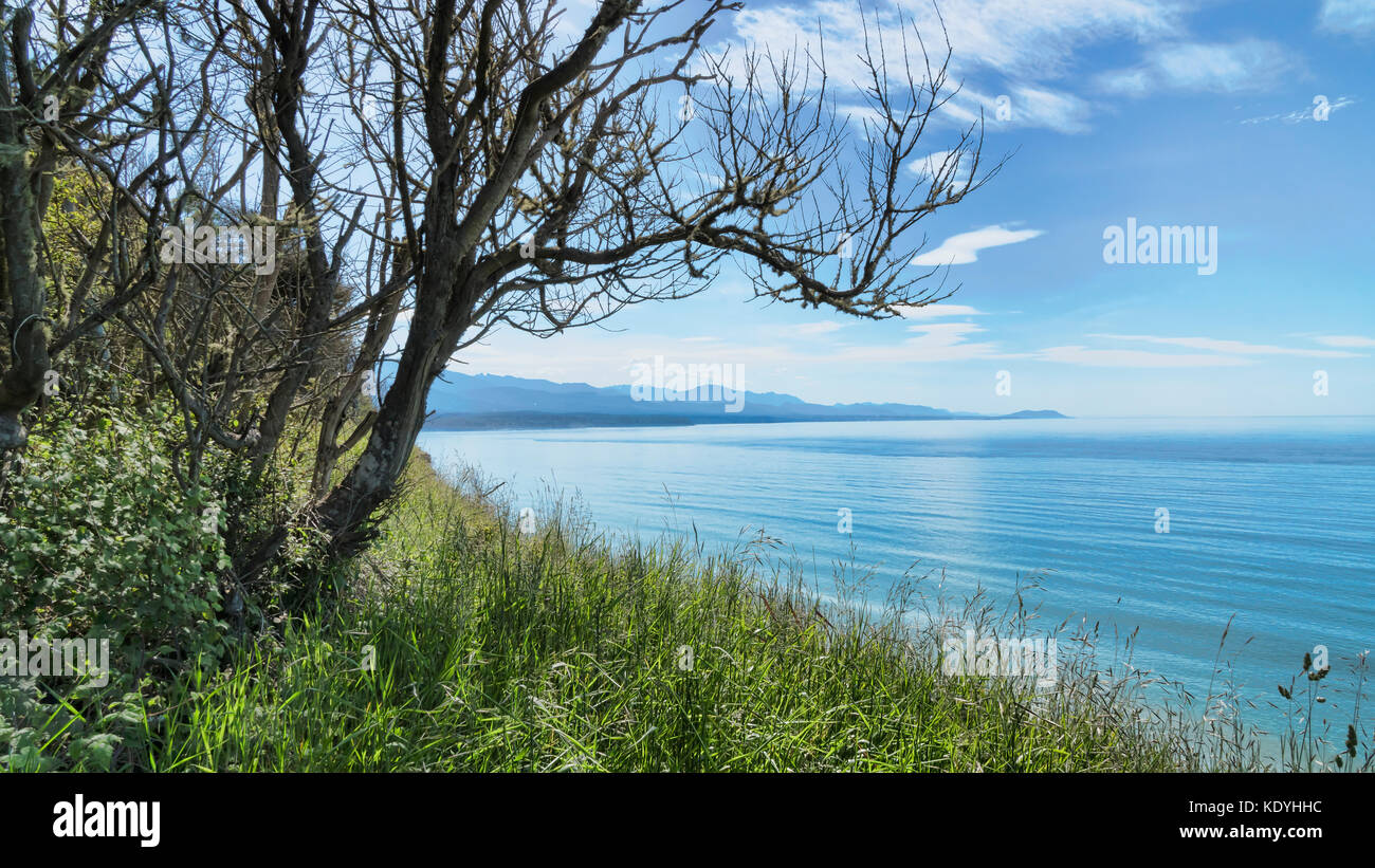 Strait of Juan de Fuca looking west from Dungeness Recreation Area, a Clallam County park near Sequim in Washington - Stock Image