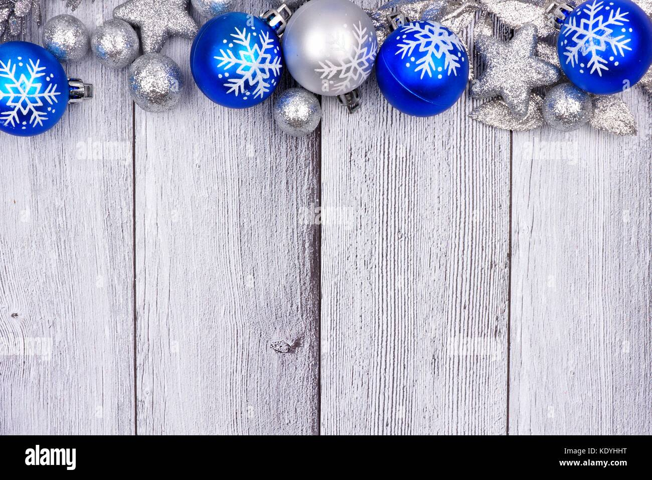 blue and silver christmas ornament top border on a rustic white wood background stock image - Blue And Silver Christmas