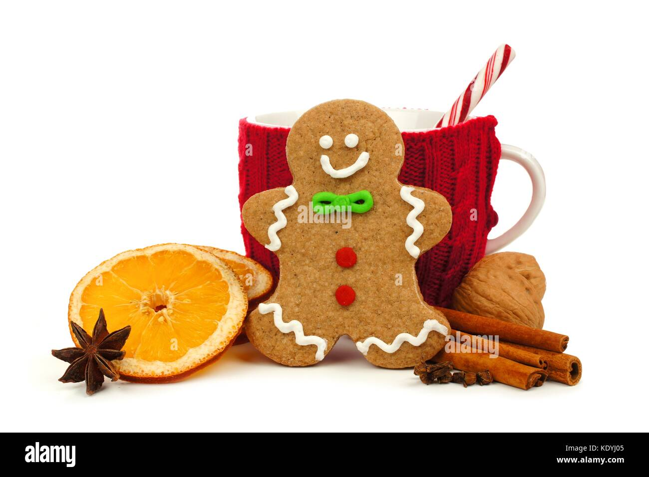 Christmas gingerbread man with festive mug and holiday spices isolated on a white background - Stock Image