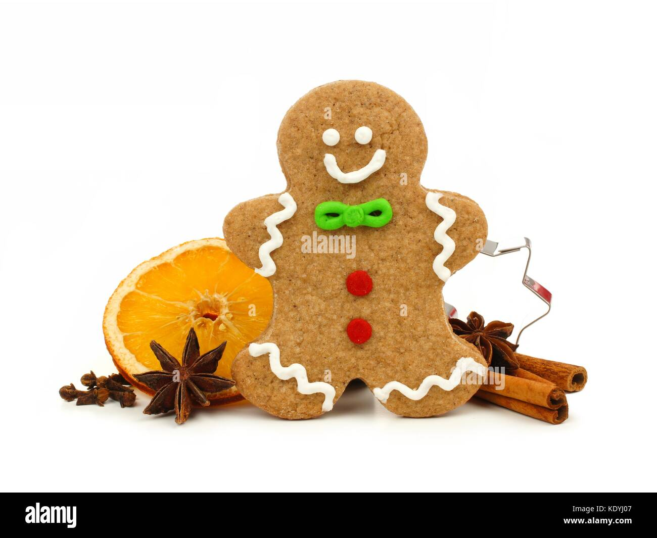 Christmas gingerbread man with cookie cutter and holiday spices isolated on a white background - Stock Image