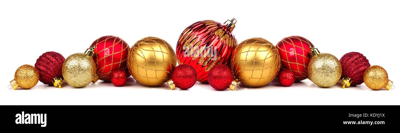 christmas border of red and gold ornaments isolated on a white background KDYJ1X