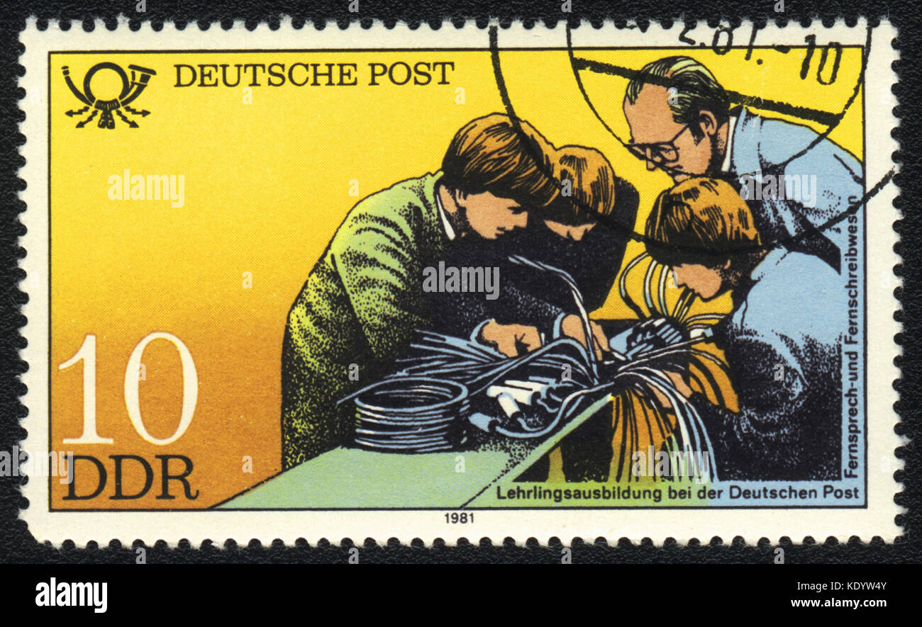 A postage stamp printed in DDR shows apprenticeship training, Postal History of Germany, circa 1981 Stock Photo