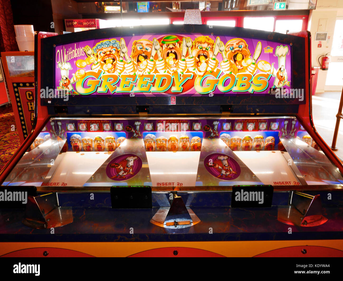 Greedy gobs penny slot machine in gaming arcade Stock Photo