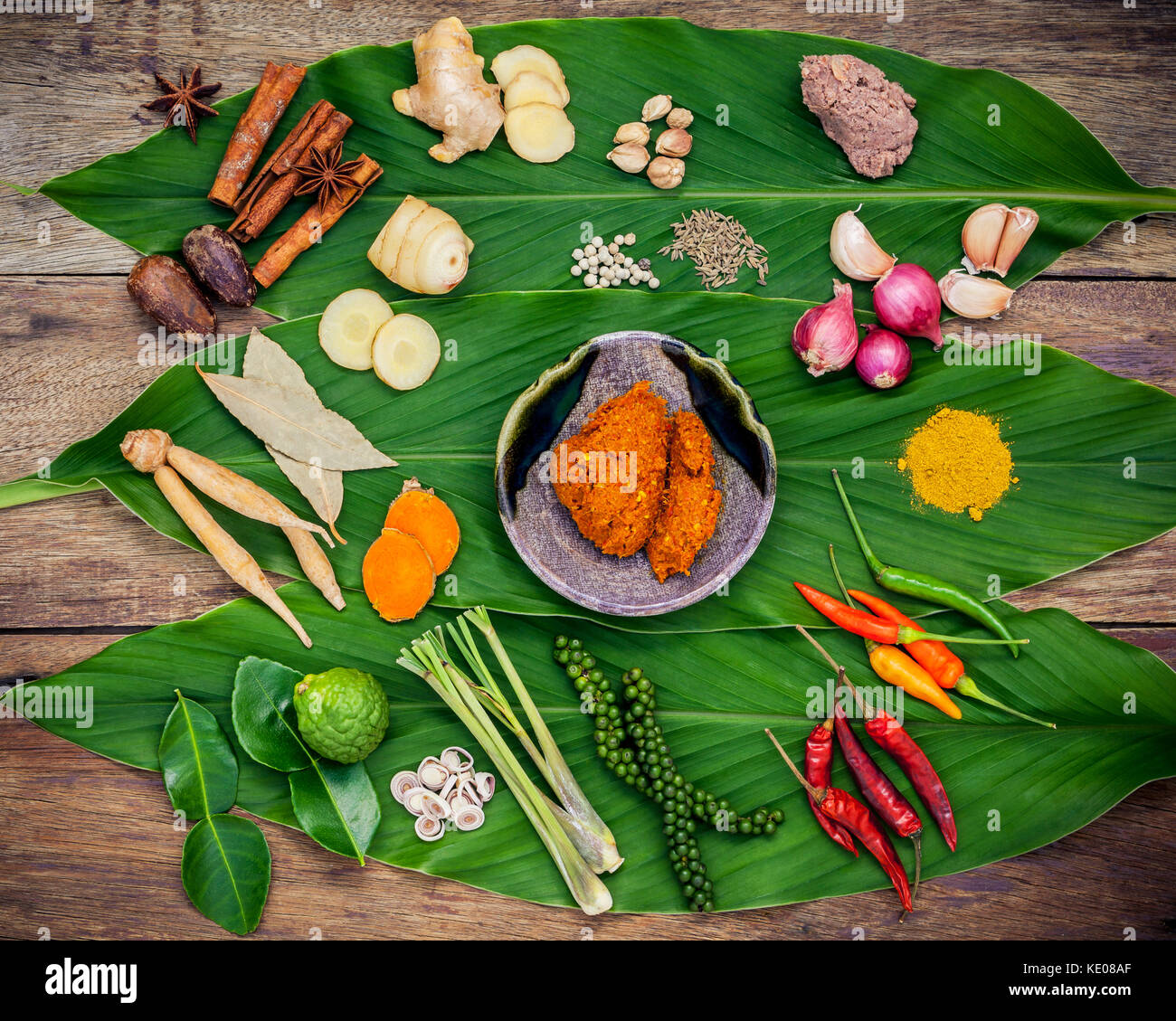 Various of Thai food Cooking ingredients and spice red curry paste ingredient of thai popular food on turmeric leaf - Stock Image