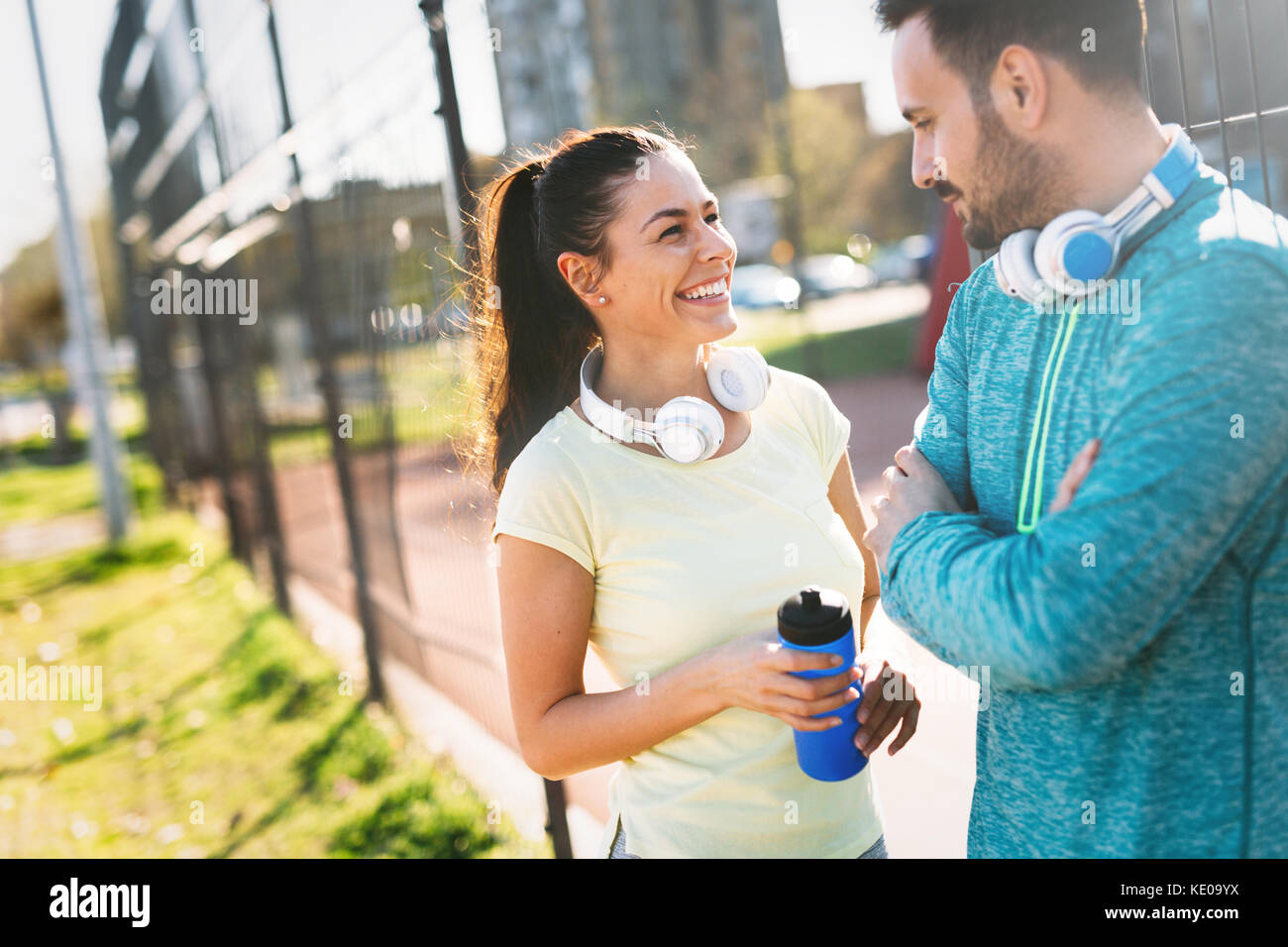 Handsome man and attractive woman talking on court - Stock Image