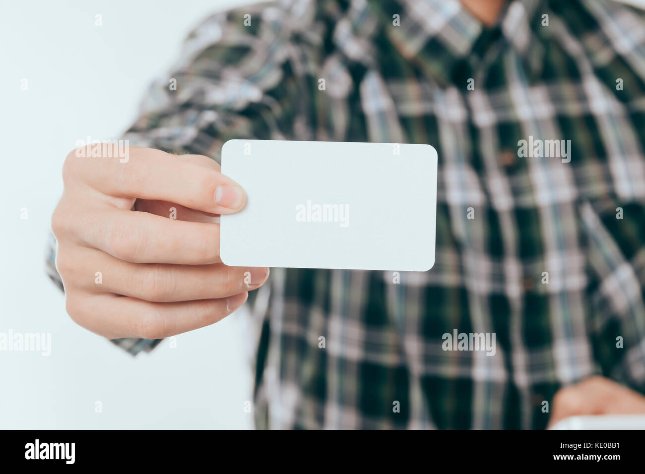 Business Card Mockup: Young Man Showing or Giving Blank Business ...
