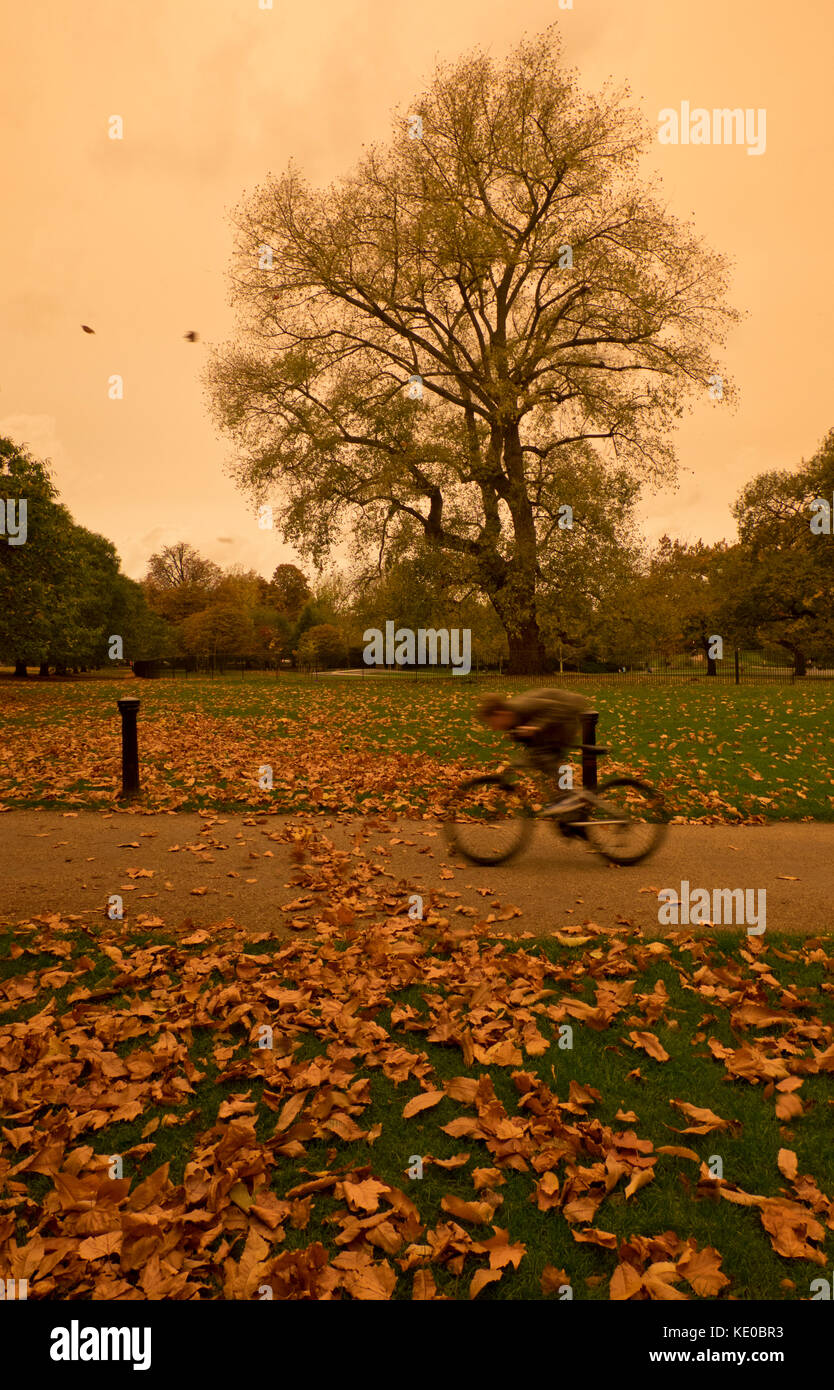 Red sky with tones of orange and sepia in parts of London as air and dust swept in from southern Europe. Unusual - Stock Image