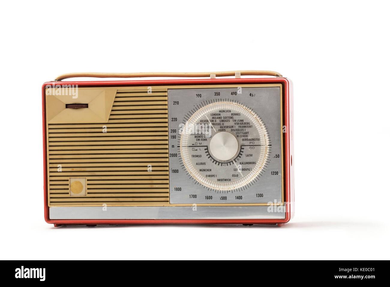 Europian antique plastic transistor radio on the white background Stock Photo