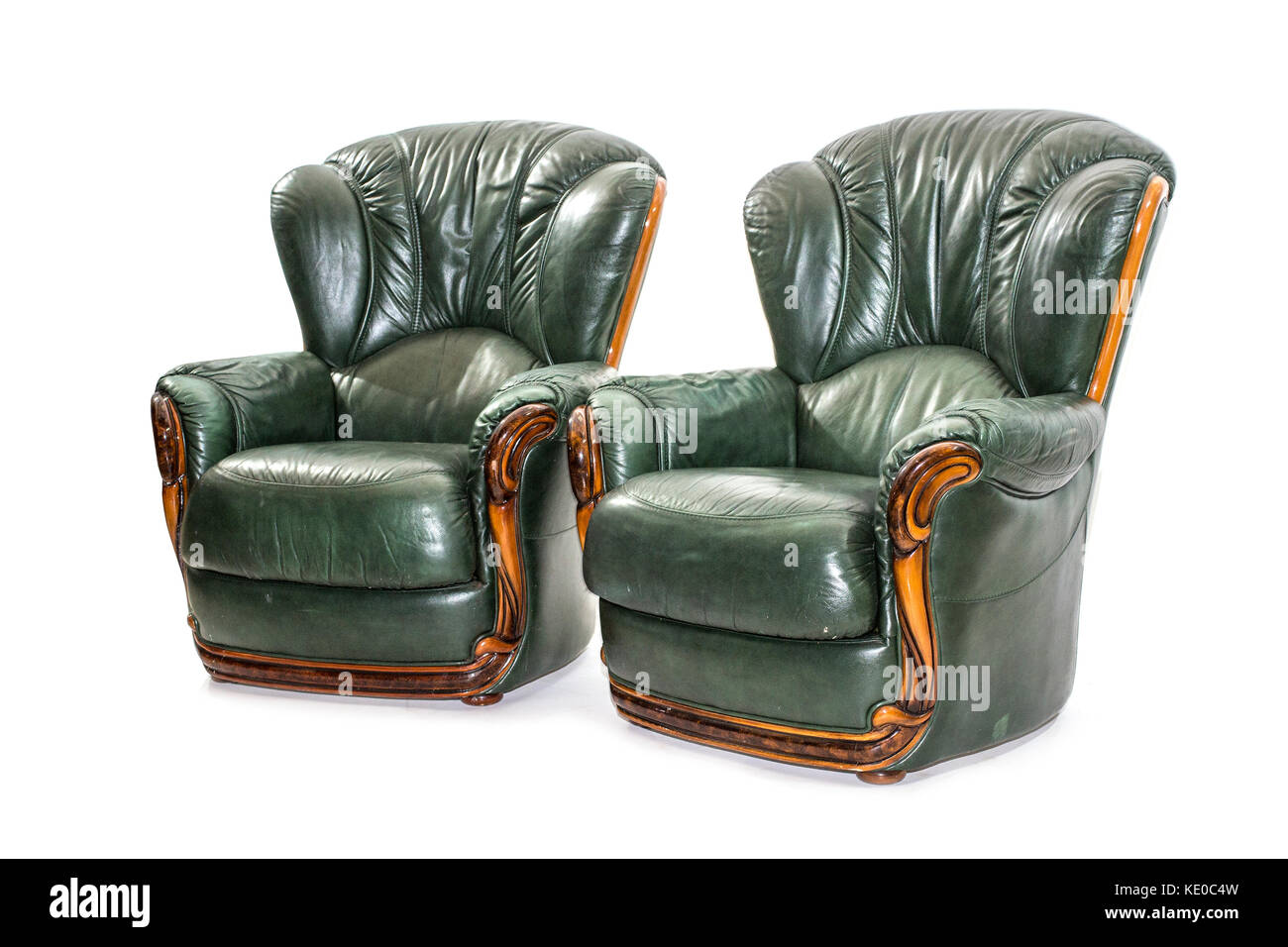 elegant brown leather arm chair on the white background. - Stock Image