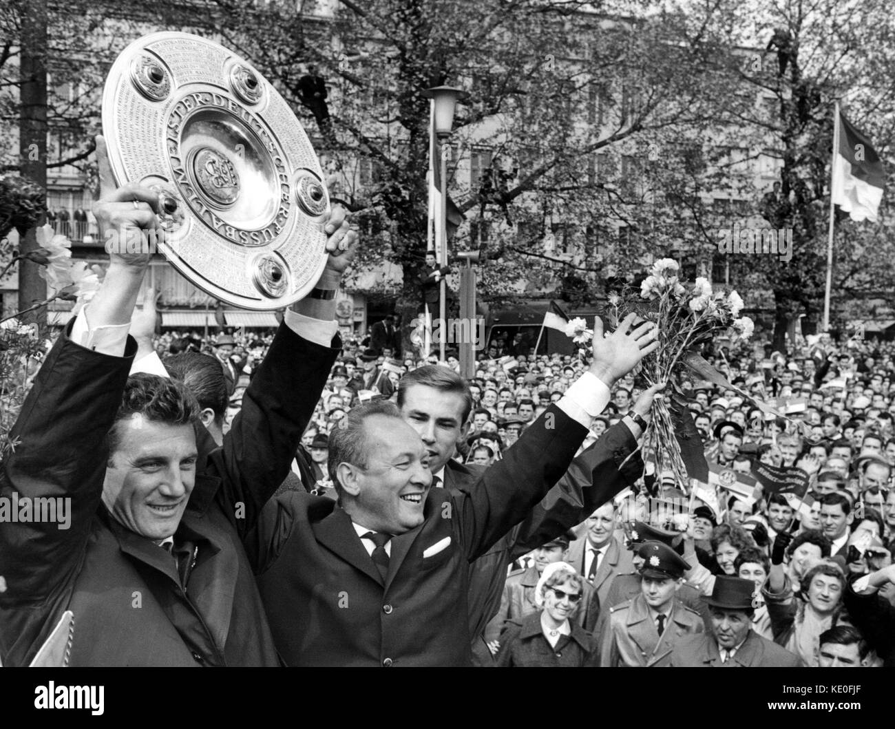 ARCHIVE - The team captain of 1. FC Cologne, Hans SChaefer holds the German Bundesliga trophy in Cologne, 13 May - Stock Image