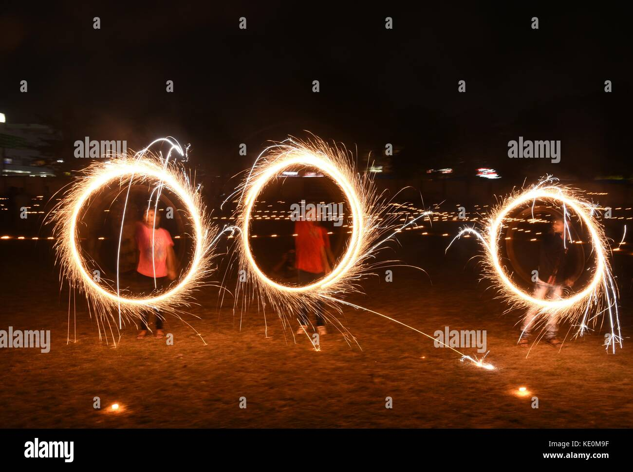 Allahabad, Uttar Pradesh, India. 17th Oct, 2017. Allahabad: Children fire sparkle cracker at Anglo Bangali stadium - Stock Image