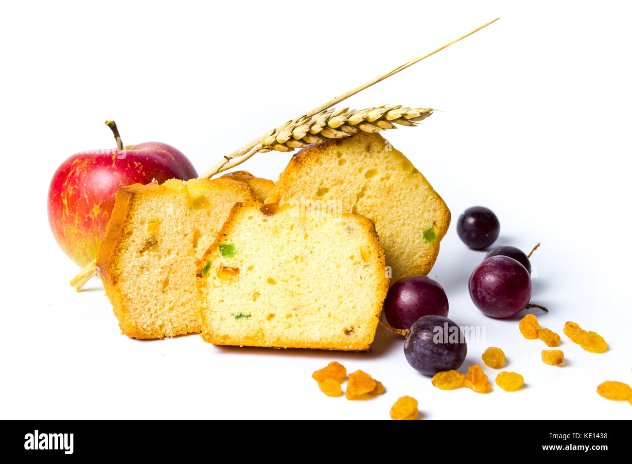 Homemade fruit bread with raisins, grape and apple on white Stock Photo