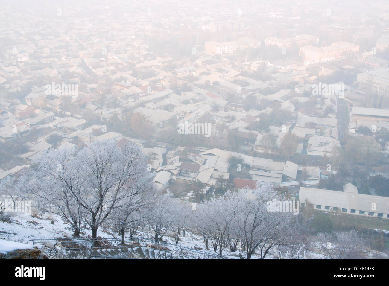 Snow-covered overview of Osh from Sulayman mountain. Osh, Fergana Valley, Kyrgyzstan - Stock Image