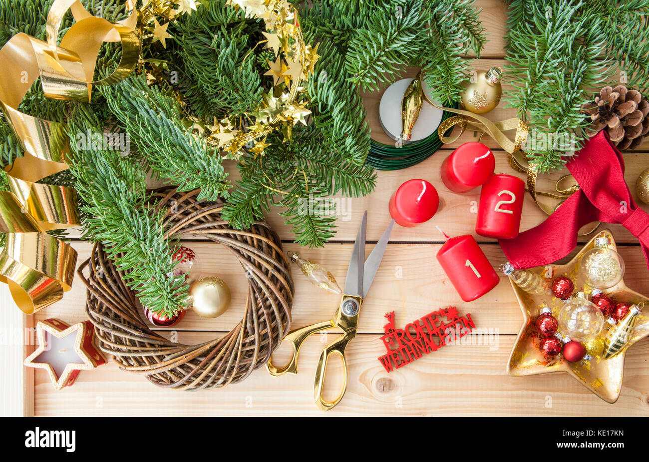Crafting an advent wreath with golden ornaments - Stock Image
