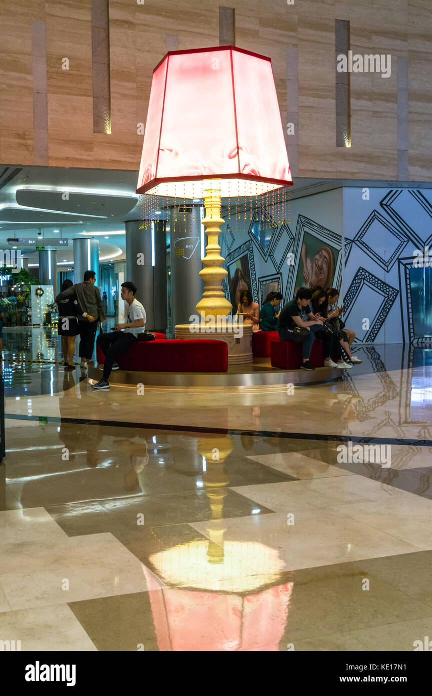 Oversized reading lamp at an upscale shopping mall in Shenzhen, China - Stock Image