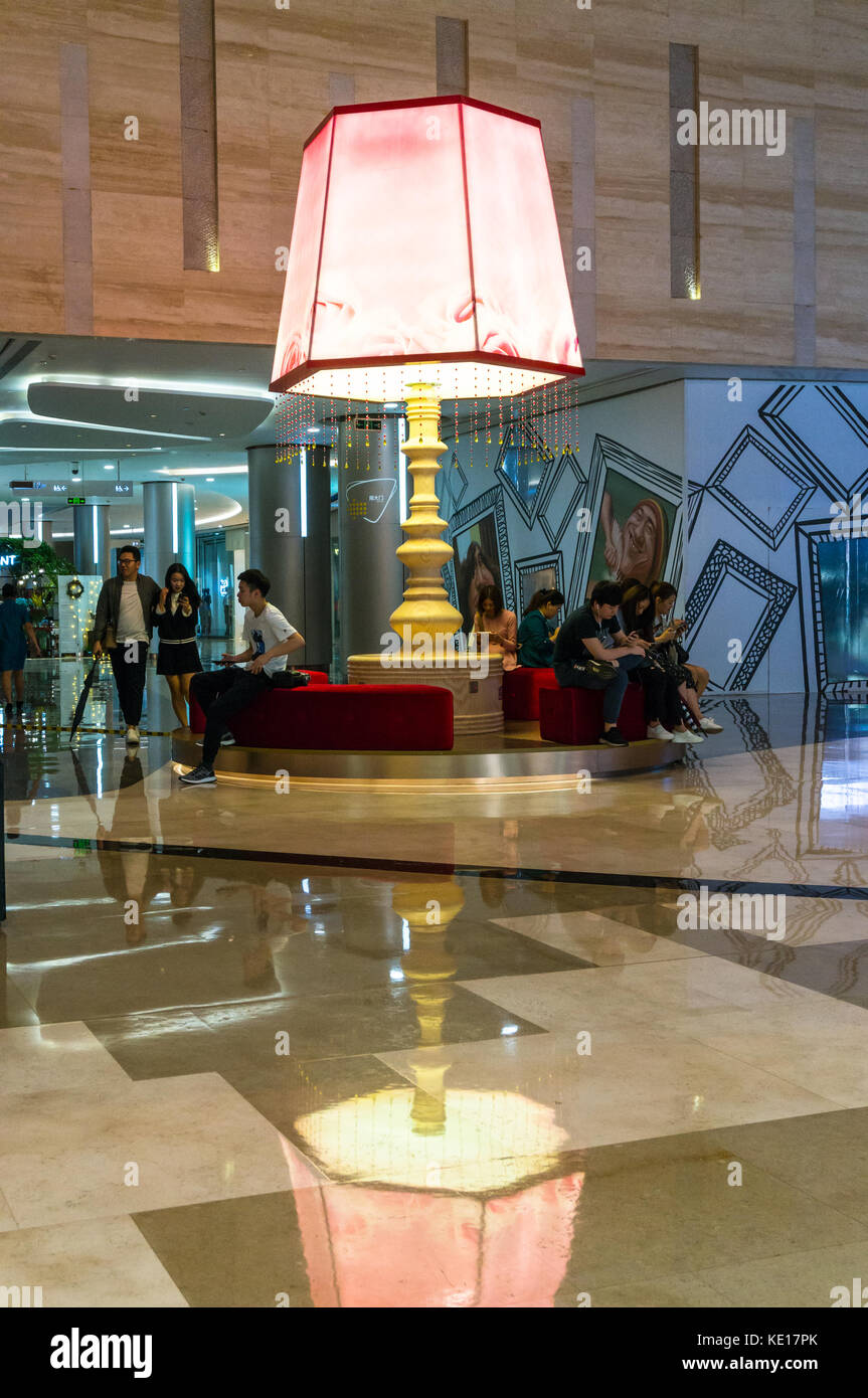 Large reading lamp at a luxury shopping mall in Shenzhen, China - Stock Image