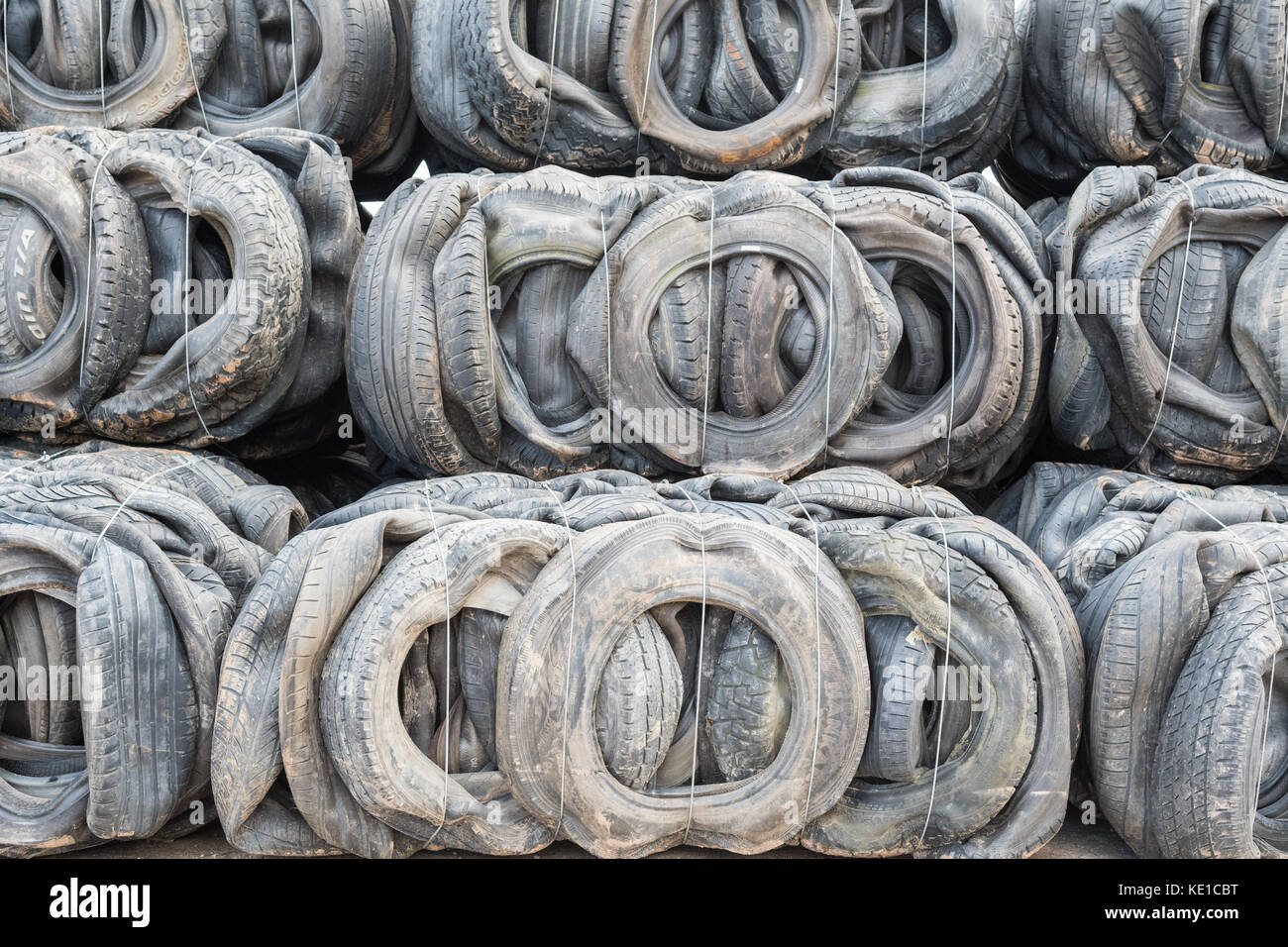 Tyre recycling - tyre bales for use in construction and/or sea defences - Stock Image