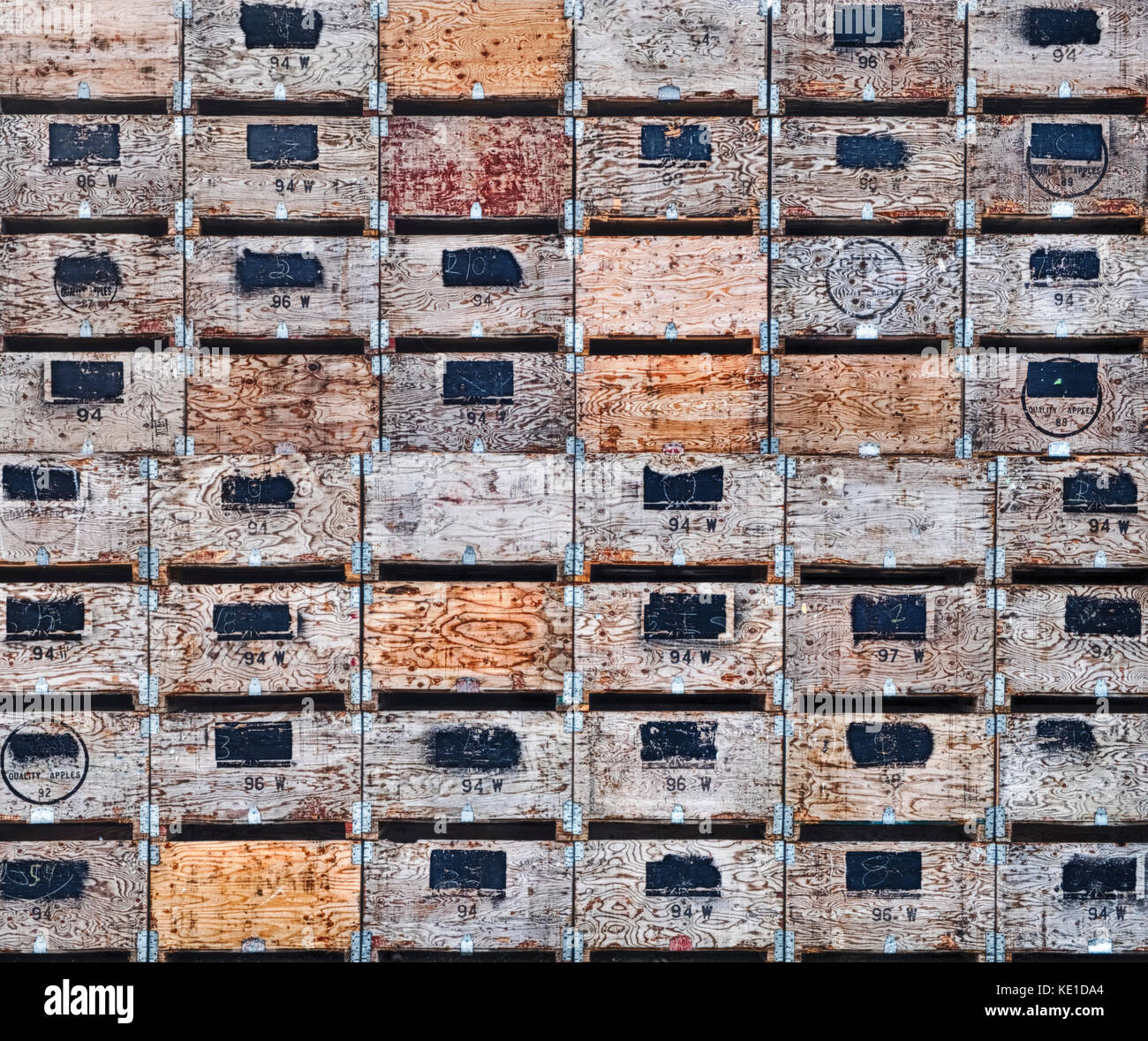 Huge stacks of wooden crates await the apple harvest in Washington State. Some of the boxes have marks indicating - Stock Image