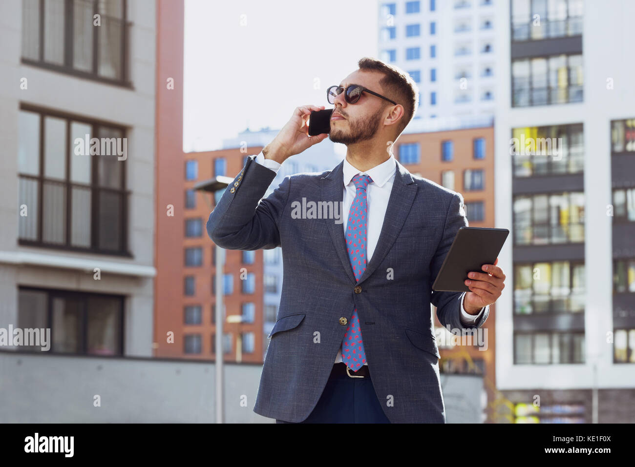 Real estate agent businessman city phone calling - Stock Image