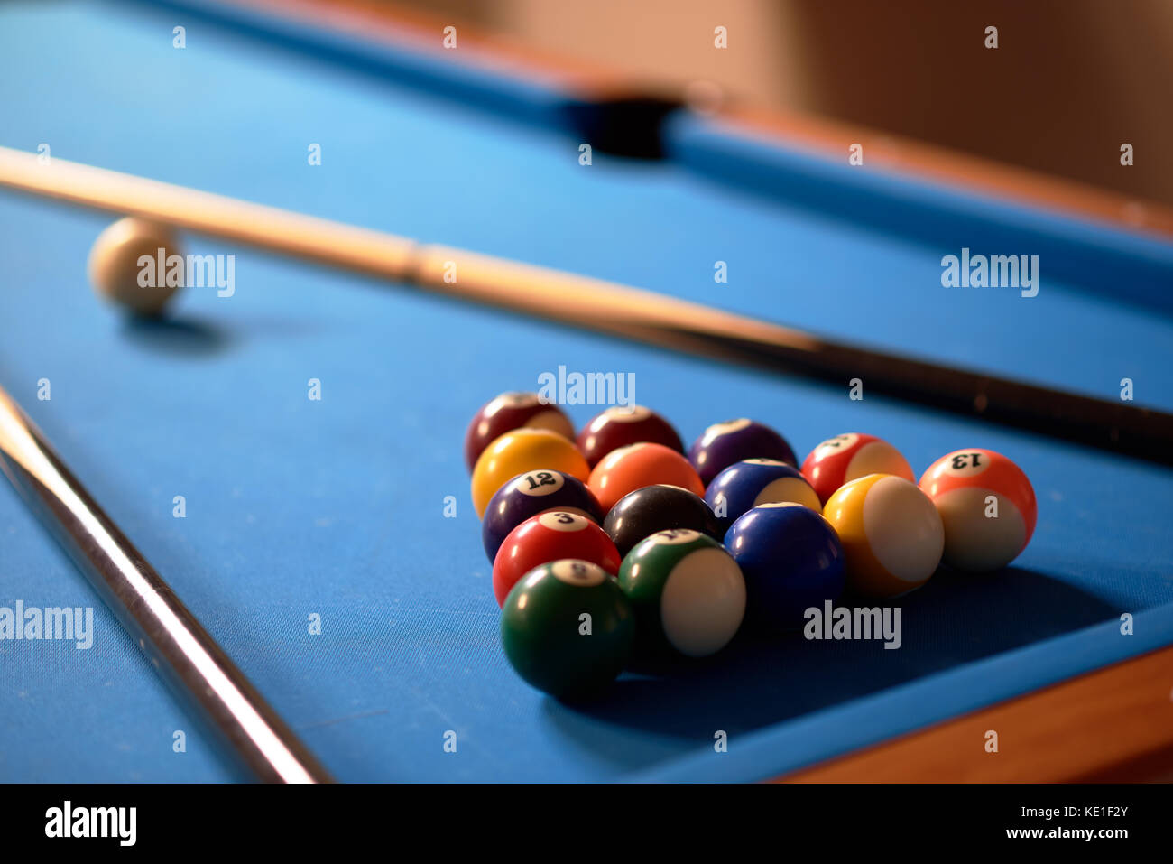 Billiard balls in a blue pool table - Stock Image