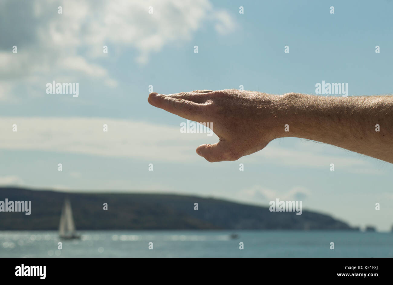 Man's arm, pointing out places of interest, gesticulating - photo - Stock Image