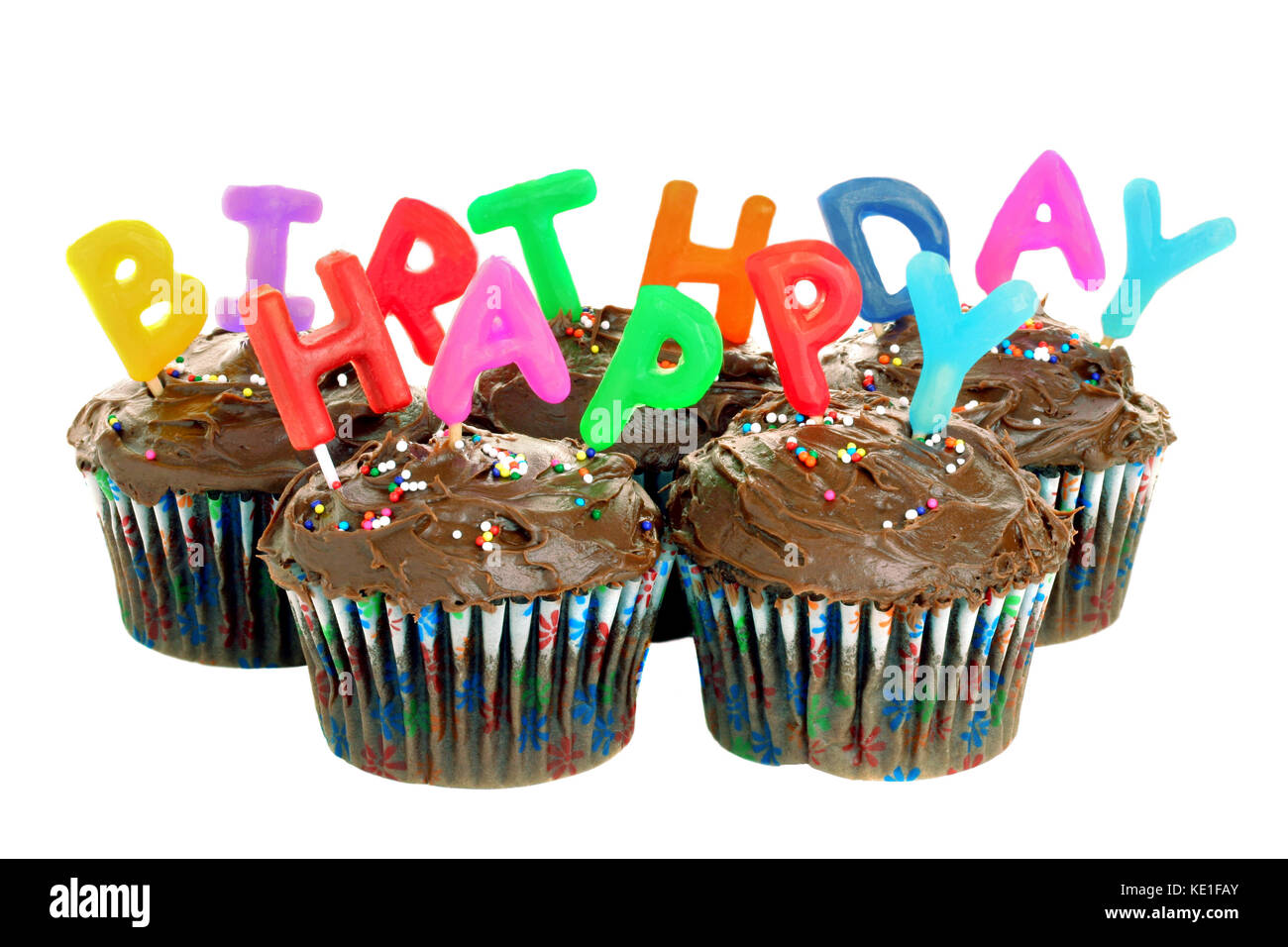 Five Chocolate Cupcakes With Candles That Spell Out Happy Birthday