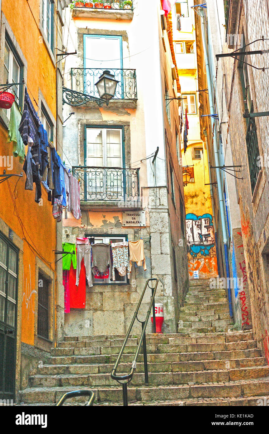 narrow streets in Alfama neighbourhood, Lisbon, Portugal - Stock Image