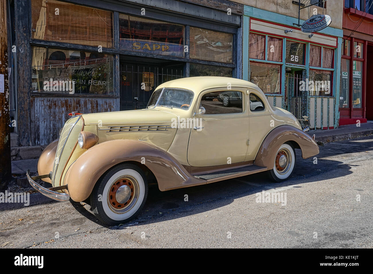 December 9, 2015 Bisbee, Arizona, USA: vintage collector's car parked in the front of victorian-style bulidings, Stock Photo