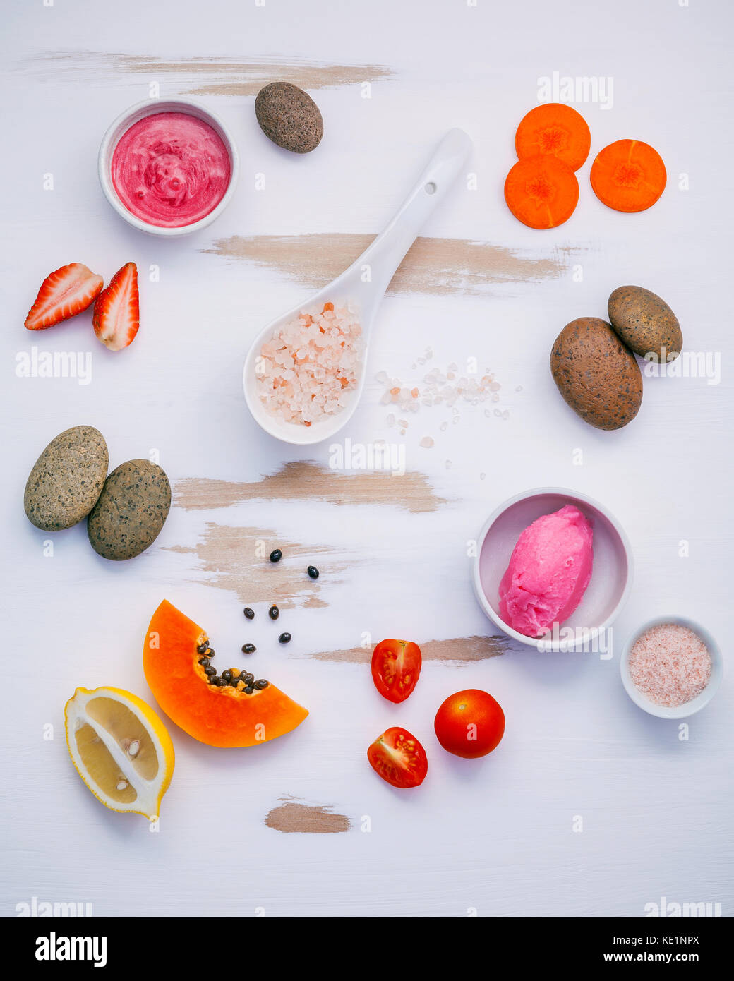 Homemade skin care and body scrubs with red natural ingredients strawberry , tomato ,himalayan salt, ripe papaya, - Stock Image