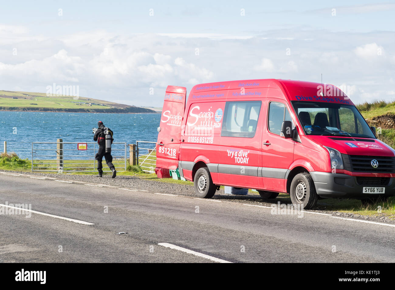 Scapa Flow diving holidays - diver and Scapa Scuba minibus at Glims Holm, Weddell Sound, Scapa Flow, Orkney Islands, - Stock Image