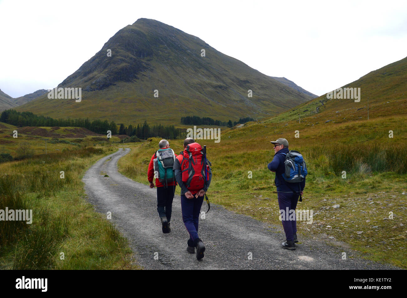 Three Hill Walkers in Gleann-leac-na-muidhe and Aonach Dudh a' Ghlinne the Northern Ridge of the Munro Sgor - Stock Image